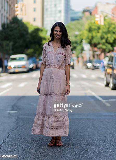 Coralie Midi wearing a dress and sandals outside Creatures of the Wind on September 8 2016 in New York City