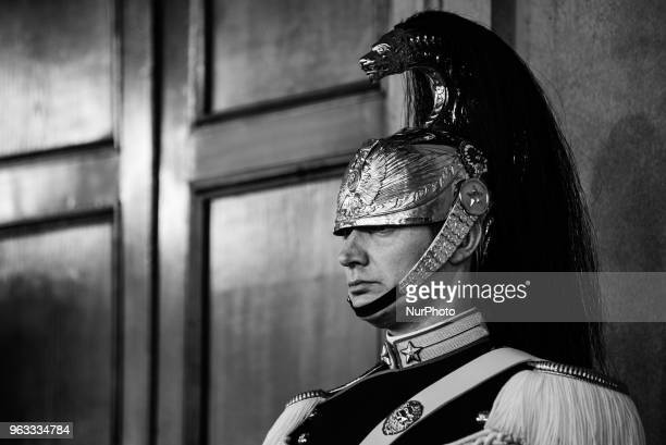 A Corazziere a soldier of the cuirassier's regiment and honour guard of the Italian presidency stands guard inside the Quirinale presidential palace...