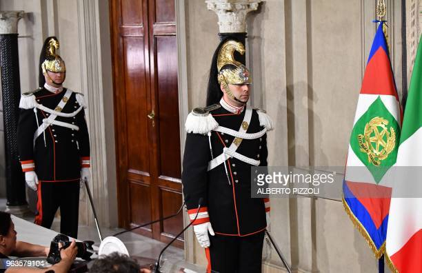 Corazzieri of the Italian military Presidential honour guards leave at the end of the meeting beetwen designated Prime Minister Carlo Cottarelli and...