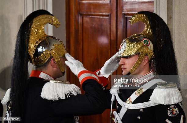 Corazzieri of the Italian military Presidential honour guards stand guard in front of the door during the meeting beetwen designated Prime Minister...