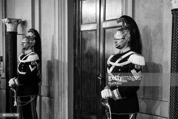 Corazzieri soldiers of the cuirassier's regiment and honour guard of the Italian presidency stand guard inside the Quirinale presidential palace in...