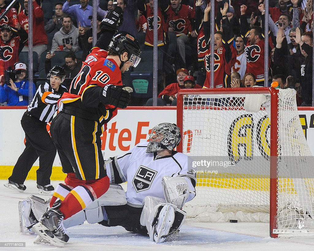 Corban Knight #10 of the Calgary Flames celebrates after the shot of his teammate Brian McGrattan #16 flew past the defence of Martin Jones #31 of the Los Angeles Kings during an NHL game at Scotiabank Saddledome on March 10, 2014 in Calgary, Alberta, Canada. The Kings defeated the Flames 3-2.