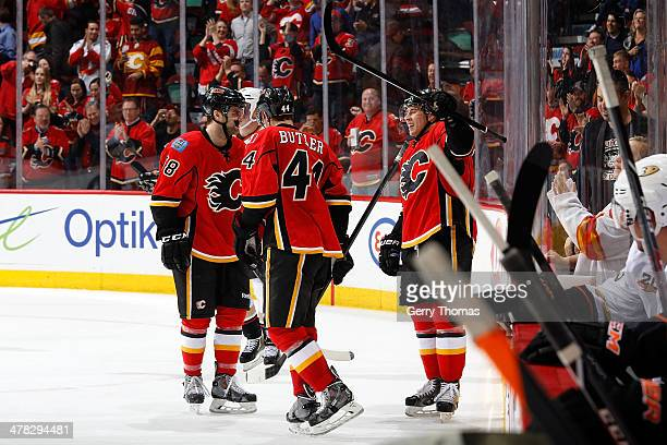 Corban Knight of the Calgary Flames celebrates his first NHL goal with his teammates against the Anaheim Ducks at Scotiabank Saddledome on March 12...