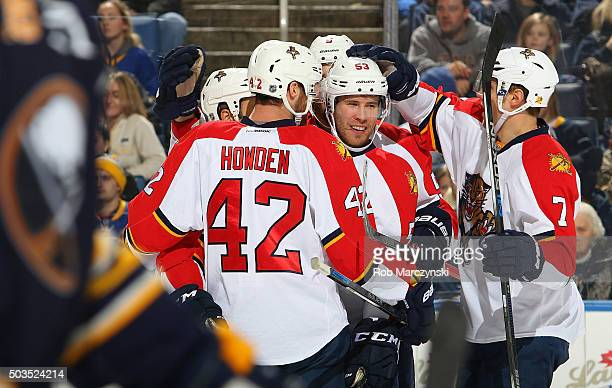 Corban Knight of the Florida Panthers celebrates his goal with Quinton Howden and Dmitry Kulikov during their 51 victory against the Buffalo Sabres...