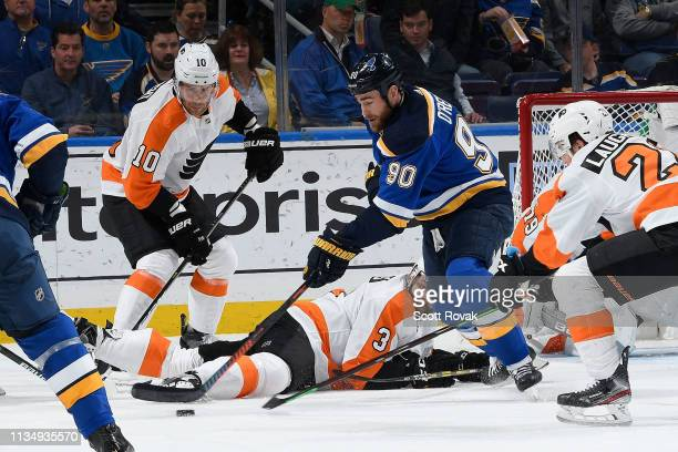 Corban Knight of the Philadelphia Flyers and Radko Gudas of the Philadelphia Flyers defend the net against Ryan O'Reilly of the St Louis Blues at...