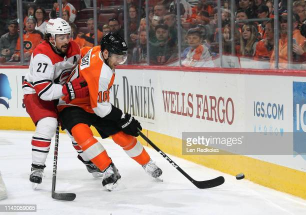 Corban Knight of the Philadelphia Flyers battles for control of the puck against Justin Faulk of the Carolina Hurricanes on April 6 2019 at the Wells...