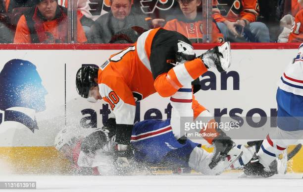 Corban Knight of the Philadelphia Flyers checks Jeff Petry of the Montreal Canadiens to the ice on March 19 2019 at the Wells Fargo Center in...