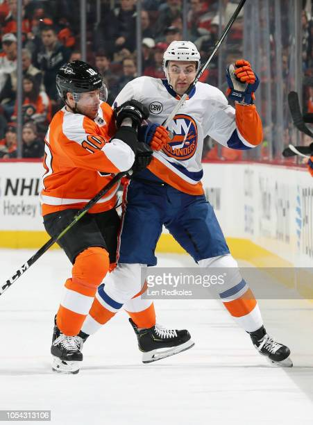 Corban Knight of the Philadelphia Flyers collides with Adam Pelech of the New York Islanders on October 27 2018 at the Wells Fargo Center in...