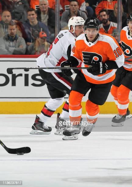 Corban Knight of the Philadelphia Flyers skates against Cody Ceci of the Ottawa Senators on March 11 2019 at the Wells Fargo Center in Philadelphia...