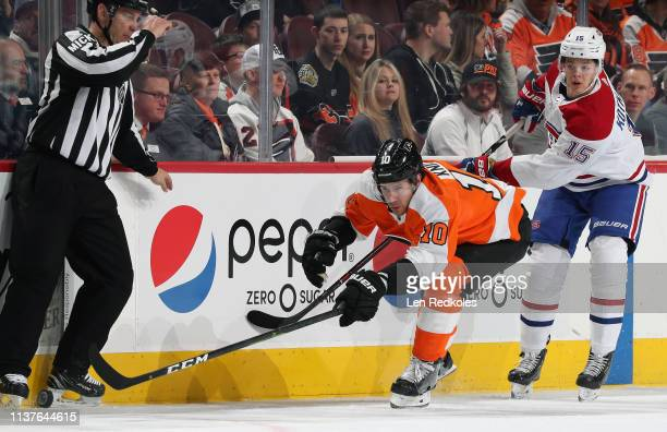 Corban Knight of the Philadelphia Flyers skates the puck against Jesperi Kothaniemi of the Montreal Canadiens on March 19 2019 at the Wells Fargo...