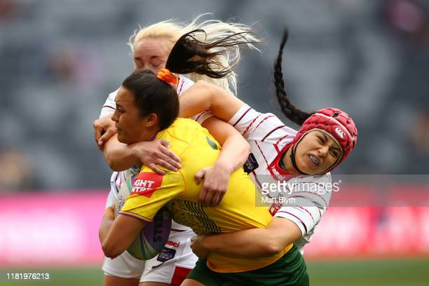 Corban McGregor of Australia is tackled during the round two Women's Rugby League World Cup 9s match between Australia and England at Bankwest...