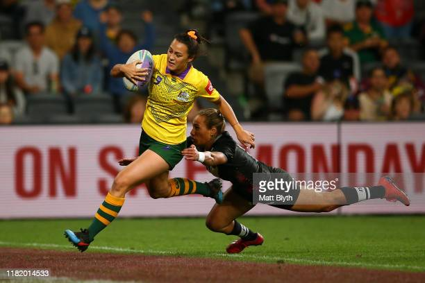Corban McGregor of Australia scores a try during Women's Rugby League World Cup 9s Final match between Australia and New Zealand at Bankwest Stadium...