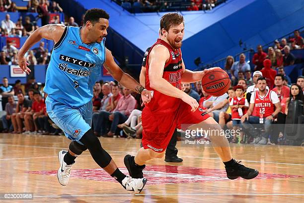 Corban Wroe of the Wildcats drives to the basket against Corey Webster of the Breakers during the round six NBL match between the Perth Wildcats and...