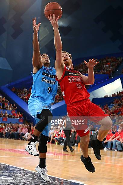 Corban Wroe of the Wildcats lays up against Corey Webster of the Breakers during the round six NBL match between the Perth Wildcats and the New...
