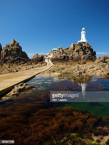 Corbiere Lighthouse, New Jersey, reflected in bay waters