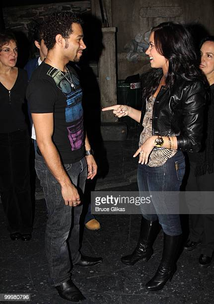 Corbin Bleu and Demi Lovato chat backstage after a performance of In The Heights on Broadway at Richard Rodgers Theatre on May 18 2010 in New York...