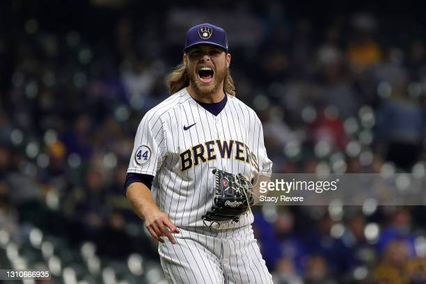 Corbin Burnes of the Milwaukee Brewers reacts to a pitch during the sixth inning against the Minnesota Twins at American Family Field on April 03,...