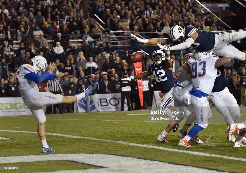 Corbin Kaufusi #90 of the Brigham Young Cougars tries to block the punt of Joel Velazquez #46 of the Boise State Broncos in the first half at LaVell Edwards Stadium on October 6, 2017 in Provo, Utah.