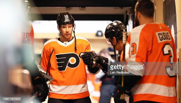 Corbin Knight of the Philadelphia Flyers gathers outside the locker room with teammates prior to warmups against the New York Islanders on October 27...