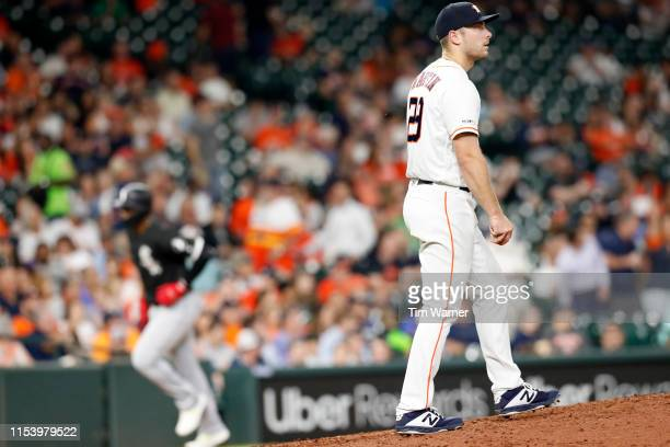 Corbin Martin of the Houston Astros reacts to a home run by Eloy Jimenez of the Chicago White Sox in the fourth inning at Minute Maid Park on May 23...