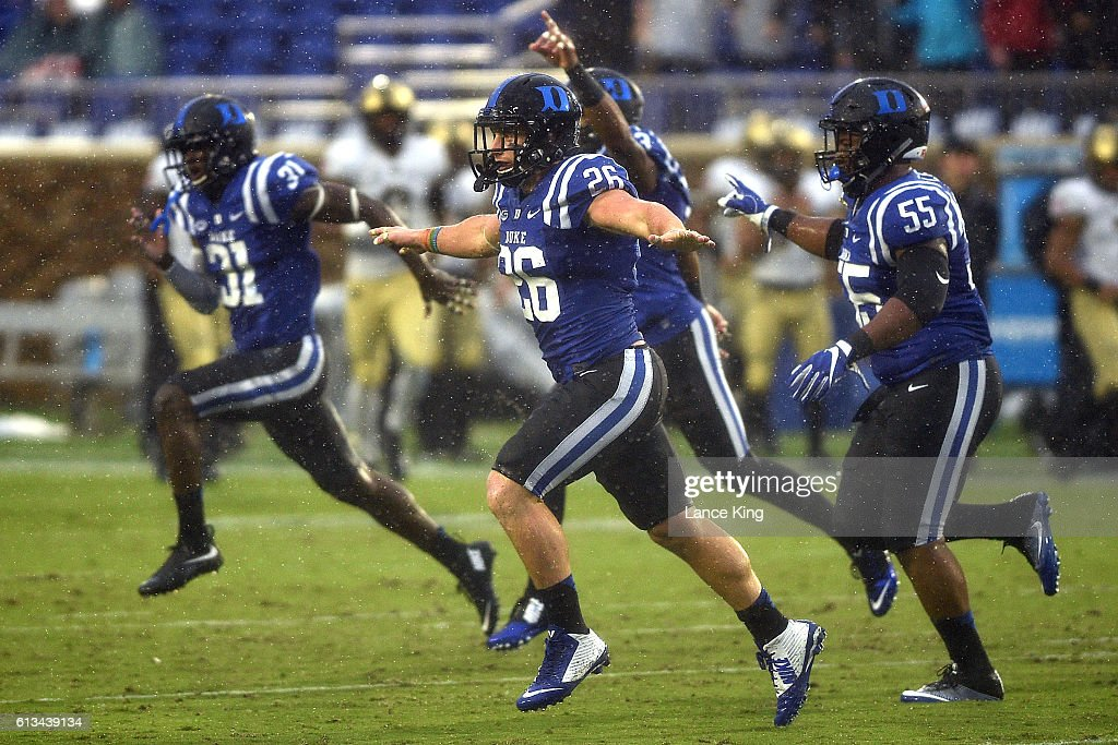 Corbin McCarthy #26 and Brandon Boyce #55 of the Duke Blue Devils celebrate following a defensive play against the Army Black Knights at Wallace Wade Stadium on October 8, 2016 in Durham, North Carolina.