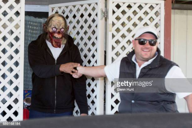 Corby security guard says goodbye to a masked occupant of Schappelle Corby's mother's house in Loganlea on May 28 2017 in Brisbane Australia...