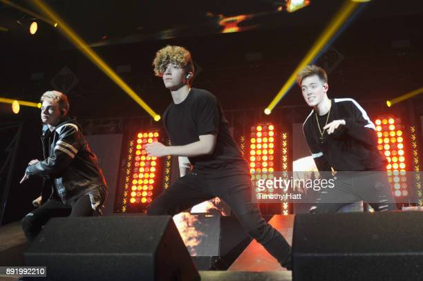 Corbyn Besson Jack Avery and Zach Herron of Why Don't We performs onstage during 1035 KISS FM's Jingle Ball 2017 at Allstate Arena on December 13...