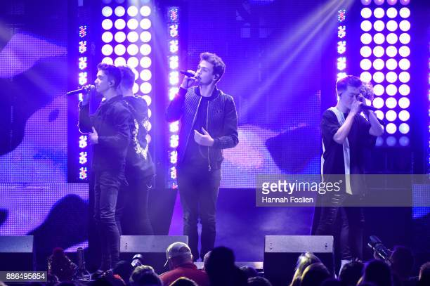 Corbyn Besson Jonah Marais and Zach Herron of Why Don't We perform onstage at 1013 KDWB's Jingle Ball 2017 at Xcel Energy Center on December 4 2017...