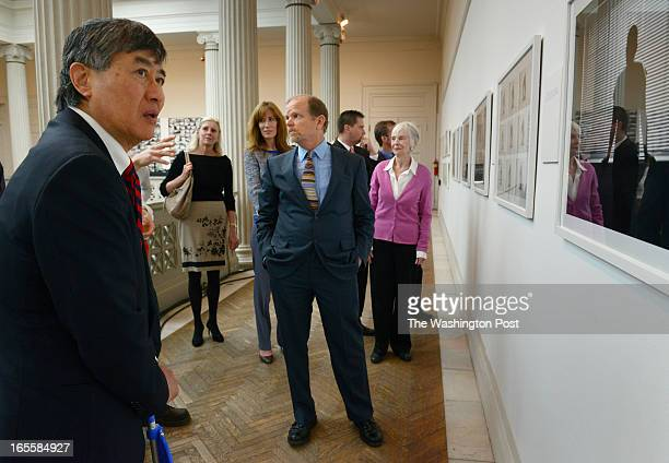 Corcoran Gallery Chairman Harry Hopper center and University of Maryland President President Wallace Loh left take a tour of the gallery on April...