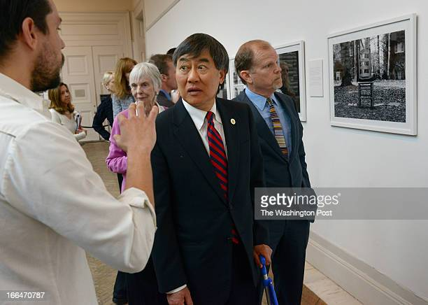 Corcoran Gallery Chairman Harry Hopper right and University of Maryland President President Wallace Loh center listen to Joe Hale Director of College...