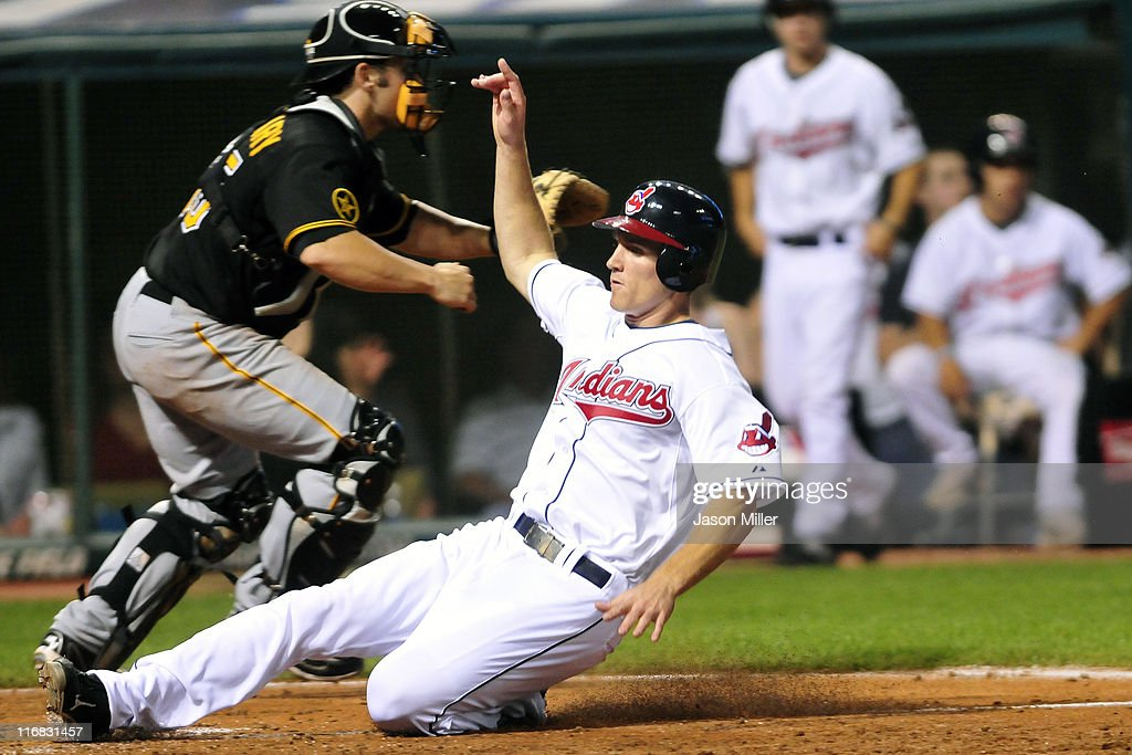 Cord Phelps #35 of the Cleveland Indians slides safely into home during the eighth inning against the Pittsburgh Pirates at Progressive Field on June 17, 2011 in Cleveland, Ohio. The Indians defeated the Pirates 5-1.