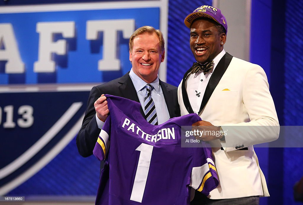 Cordarelle Patterson (L) of the Tennessee Volunteers stands with NFL Commissioner Roger Goodell as they hold up a jersey after Patterson was selected #29 overall by the Minnesota Vikings in the first round of the 2013 NFL Draft at Radio City Music Hall on April 25, 2013 in New York City.