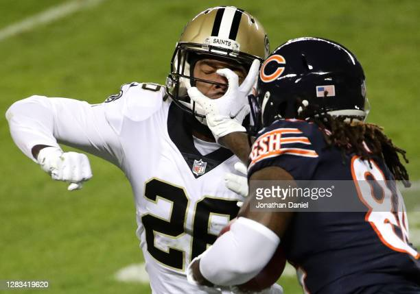 Cordarrelle Patterson of the Chicago Bears stiff arms P.J. Williams of the New Orleans Saints on a kickoff in the second half at Soldier Field on...