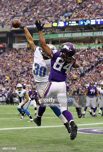 Cordarrelle Patterson of the Minnesota Vikings attempts to pull in a pass while Darius Slay of the Detroit Lions blocks it on December 29, 2013 at...