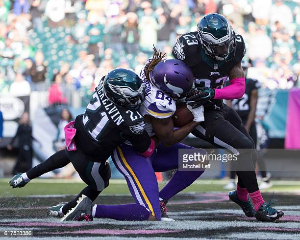 Cordarrelle Patterson of the Minnesota Vikings catches a touchdown pass against Leodis McKelvin and Rodney McLeod of the Philadelphia Eagles in the...