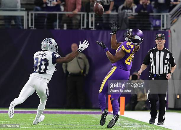 Cordarrelle Patterson of the Minnesota Vikings catches the ball over defender Anthony Brown of the Dallas Cowboys in the first quarter of the game on...