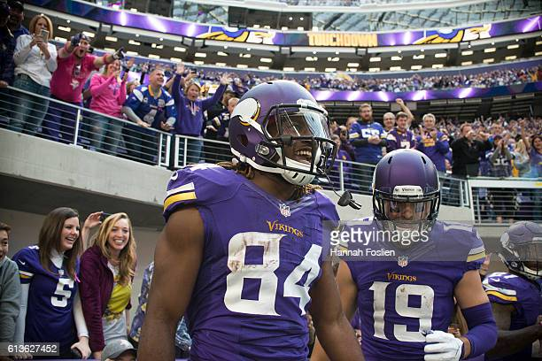 Cordarrelle Patterson of the Minnesota Vikings celebrates a 9 yard catch to score a touchdown during the fourth quarter of the game against the...