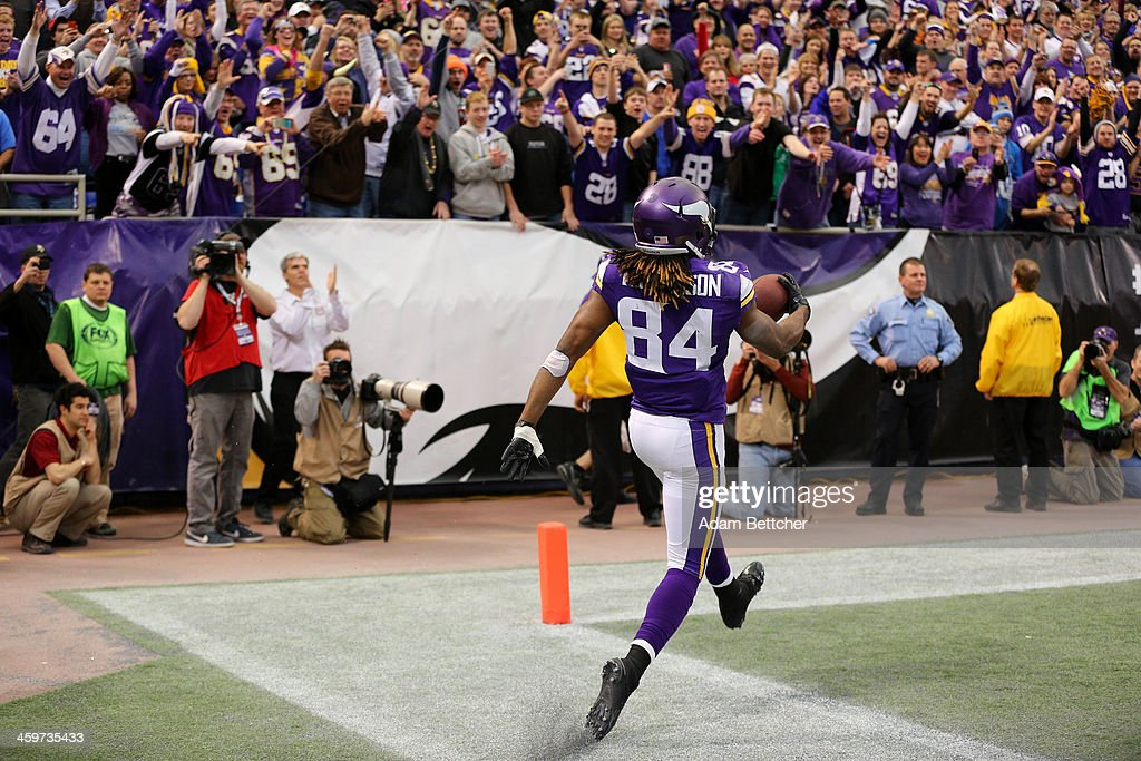 Cordarrelle Patterson #84 of the Minnesota Vikings celebrates a touchdown to win the game against the Detroit Lions on December 29, 2013 at Mall of America Field at the Hubert H. Humphrey Metrodome in Minneapolis, Minnesota.