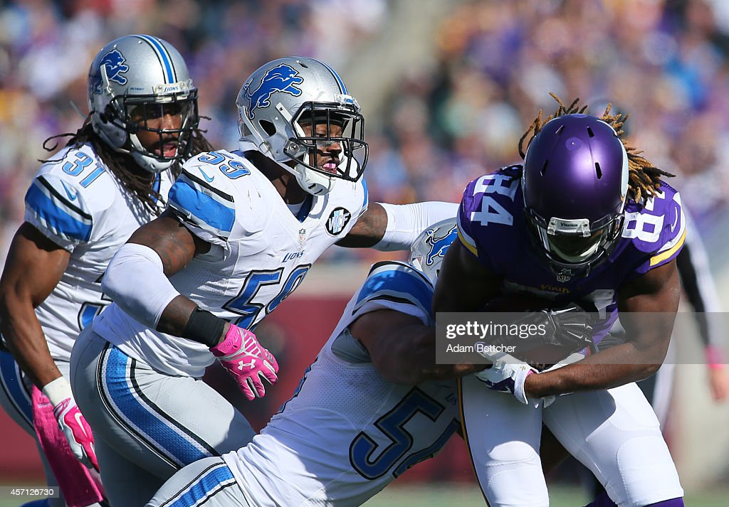 Cordarrelle Patterson #84 of the Minnesota Vikings runs the ball against the Detroit Lions during the fourth quarter on October 12, 2014 at TCF Bank Stadium in Minneapolis, Minnesota.