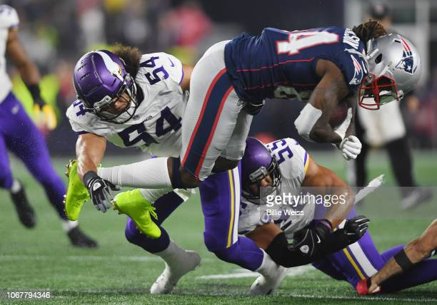 Cordarrelle Patterson of the New England Patriots is tackled by Eric Kendricks and Anthony Barr of the Minnesota Vikings during the first half at...