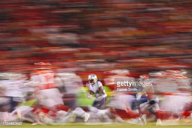 Cordarrelle Patterson of the New England Patriots runs back a kickoff in the second half against the Kansas City Chiefs during the AFC Championship...