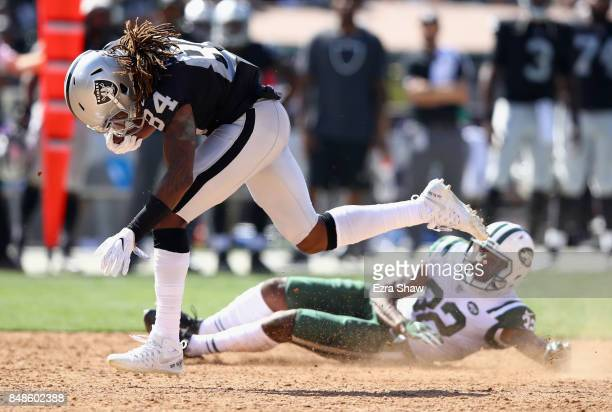 Cordarrelle Patterson of the Oakland Raiders breaks free from Juston Burris of the New York Jets to score a touchdown at OaklandAlameda County...