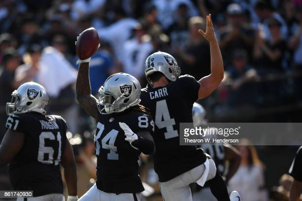 Cordarrelle Patterson of the Oakland Raiders celebrates with Derek Carr after a 47yard touchdown against the Los Angeles Chargers during their NFL...