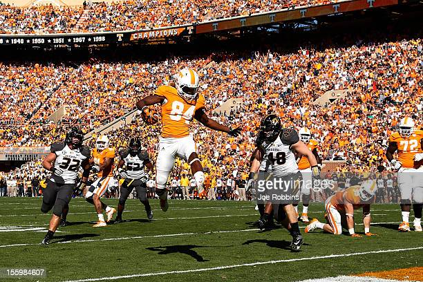 Cordarrelle Patterson of the Tennessee Volunteers leaps into the end zone for a five-yard touchdown against the Missouri Tigers during the game at...
