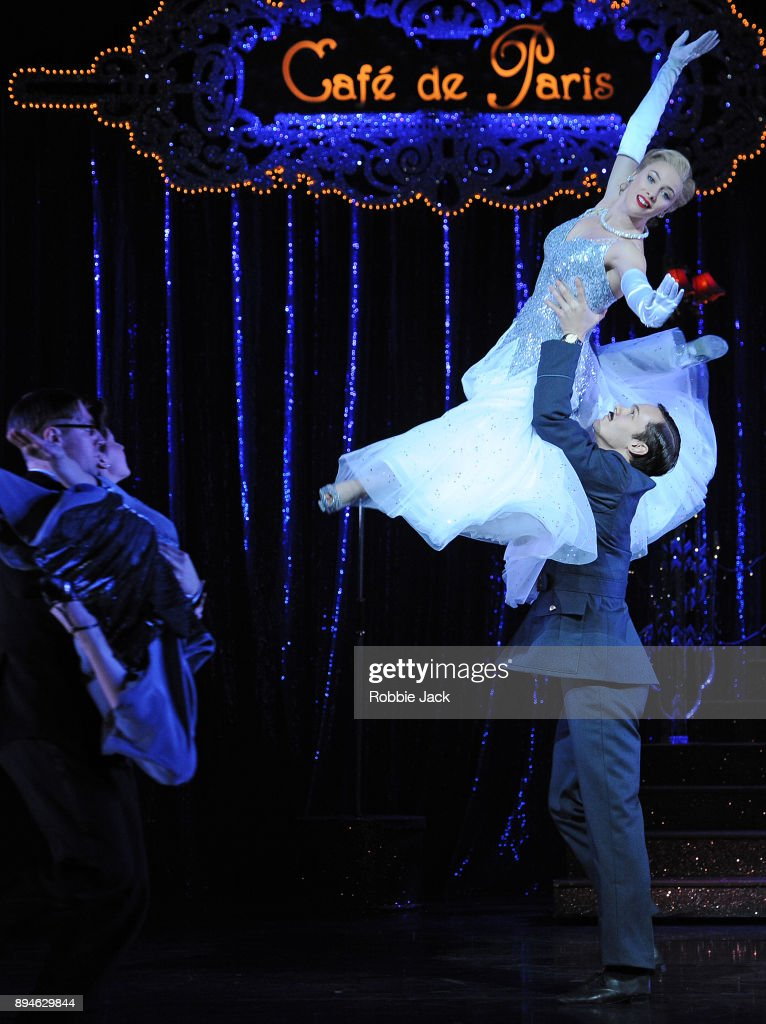 Cordelia Braithwaite as Cinderella and Will Bozier as Harry with artists of the company in Matthew Bourne's Cinderella at Sadler's Wells Theatre on December 15, 2017 in London, England.