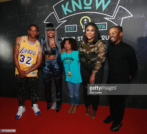 Cordell Broadus Karen Civil Nina Parker and Chris Grace pose with students as AHF presents the Know Your Status tour on April 26 2017 in Houston Texas