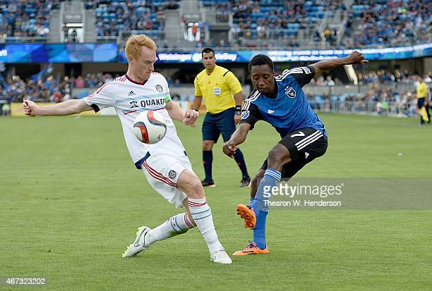 Cordell Cato of San Jose Earthquakes gets his shot on goal past Jeff Larentowicz of Chicago Fire during the second half at Avaya Stadium on March 22...