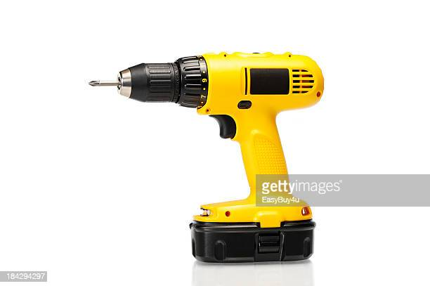 cordless yellow power drill isolated on a white background - drill stock pictures, royalty-free photos & images