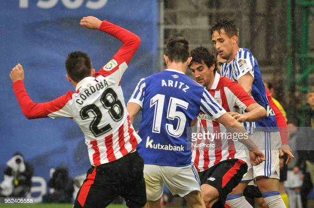 Cordoba and San Jose of Athletic Club duels for the ball with Aritz Elustondo amd Adnan Januzaj of Real Sociedad during the Spanish league football...