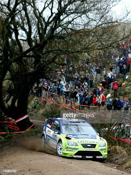 Finnish driver Marcus Gronholm powers his Ford Focus RS WRC 06 with his codriver Timo Rautianinen during the 10th stage of the Argentina Rally in...